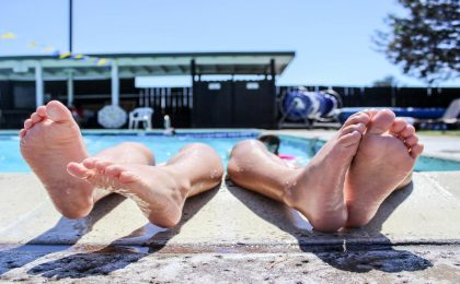 shpws two sets of feet on pool edge income in retirement